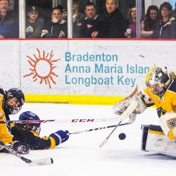 Connecticut Whale Forward Kelly Babstock gets a shot off while getting taken down by New York Riveters Defenseman Courtney Burke at the NWHL All-Star game in Pittsburgh.