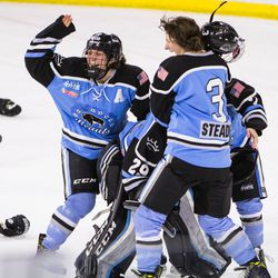 Buffalo Beauts Megan Bozek and Kelly Steadman engage in the ritual throwing of equipment and cackling like crazy people following their Isobel Cup Final upset over the Boston Pride.