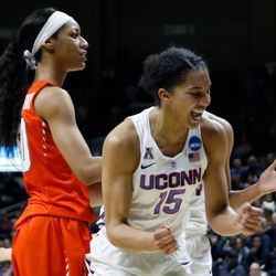 UConn's Gabby Williams (15) celebrates after making a layup and being fouled.<br>