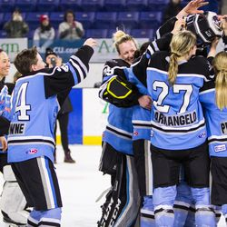 The Beauts lift the cup.