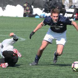 Midfielder Blake Townes gets by Santi Moar