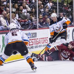 Moroz battles for the puck after taking a hit and falling to the ice