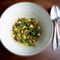 Salad of broccolis, chois, puffed grains, and ricotta