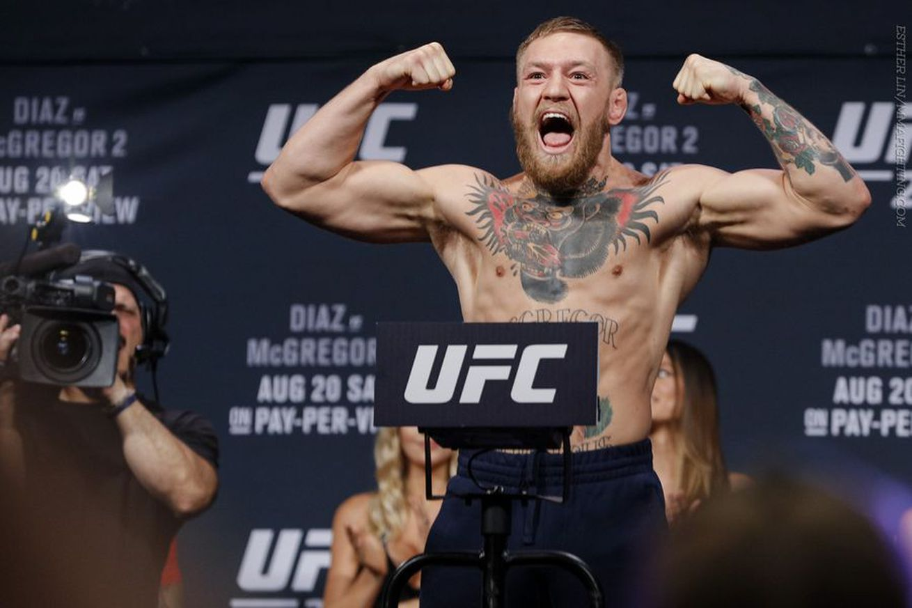 community news, UFC 202 results: Conor McGregor defeats Nate Diaz via majority decision in all time classic