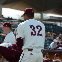 Sophomore Garvin Alston Jr. celebrates opening day with his teammates