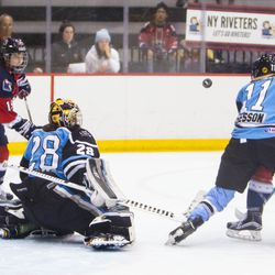 The New York Riveters and Buffalo Beauts track a deflected puck through the air during their Isobel Cup Semi-Final game in NJ.