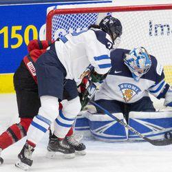 Team Finland goaltender Noora Raty makes a save
