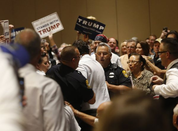 A protester is removed from a Trump rally.