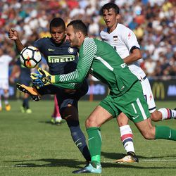 Henrique Dalbert and Samir Handanovic of Internazionale in action during the Serie A match between FC Crotone and FC Internazionale at Stadio Comunale Ezio Scida on September 16, 2017 in Crotone, Italy.