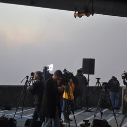 The dust cloud moving toward reporters.