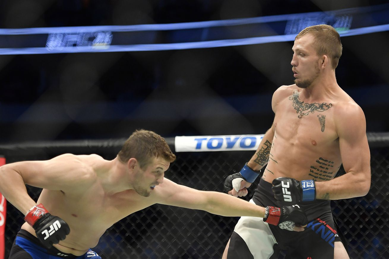 Knockout! Watch Jason Knight  finish Chas Skelly late at UFC 211 in Texas