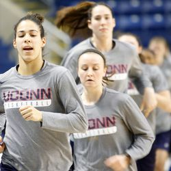 UConn guard Kia Nurse leads the team as they run around the court before their Sweet 16 practice.<br>