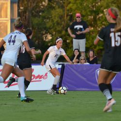 MANHATTAN, KANSAS - Kansas State midfielder Laramie Hall (23) lines up a pass as forward Tatum Wagner (44) looks on during K-State's 2-0 victory over Omaha on August 30, 2017.
