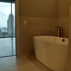 The master bath of the last available penthouse.