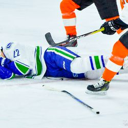 Daniel Sedin goes down after Del Zotto hits him in the face with his stick