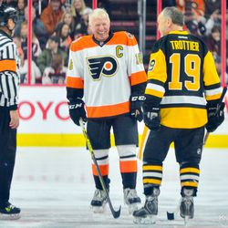 Bobby Clarke with Bryan Trottier before puck drop