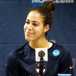 UConn's Kia Nurse (11) is all smiles during the postgame press conference.