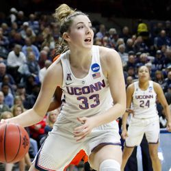 UConn's Katie Lou Samuelson (33) drives to the basket.