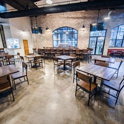 Though elements like exposed brick evoke old New Orleans, the cavernous space feels fresh and new.
