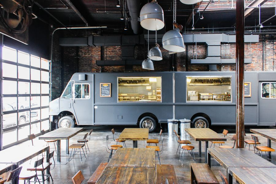 Settle Onto A Patio And Eat From Indoor Food Trucks This
