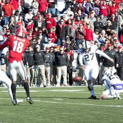 Brandon Hatfield makes contact on a field goal attempt.