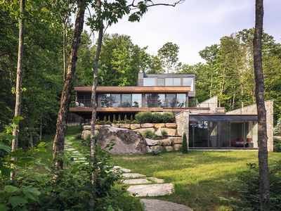 'Floating' timber modern house in the woods offers mod take on rustic
