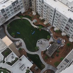 Looking down to the greenspace and grilling areas from the 21st floor.
