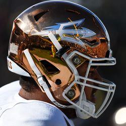 """A variation on the """"Desert Ice"""" uniform, the Sun Devils wore metallic golf helmets in Eugene against the Ducks"""