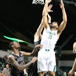 Nick Madray going hard to the basket.<br>