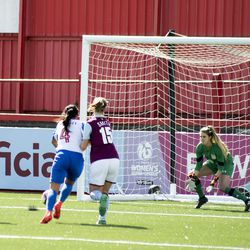 Grace Smith fends off a Brighton player while Claire Skinner prepares to collect the ball.