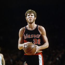 Bill Walton models the team's classic 1977-91 look.<br>MILWAUKEE, WI - CIRCA 1977: Bill Walton #32 of the Portland Trail Blazers looks to shoot a free throw against the Milwaukee Bucks during an NBA basketball game circa 1977 at the MECCA Arena in Milwaukee, Wisconsin. Walton played for the Trailblazers from 1974 - 79. (Photo by Focus on Sport/Getty Images)