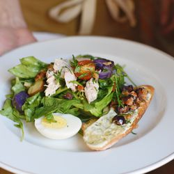 Nicoise salad with tuna confit, market beans, herb aioli, and a baguette