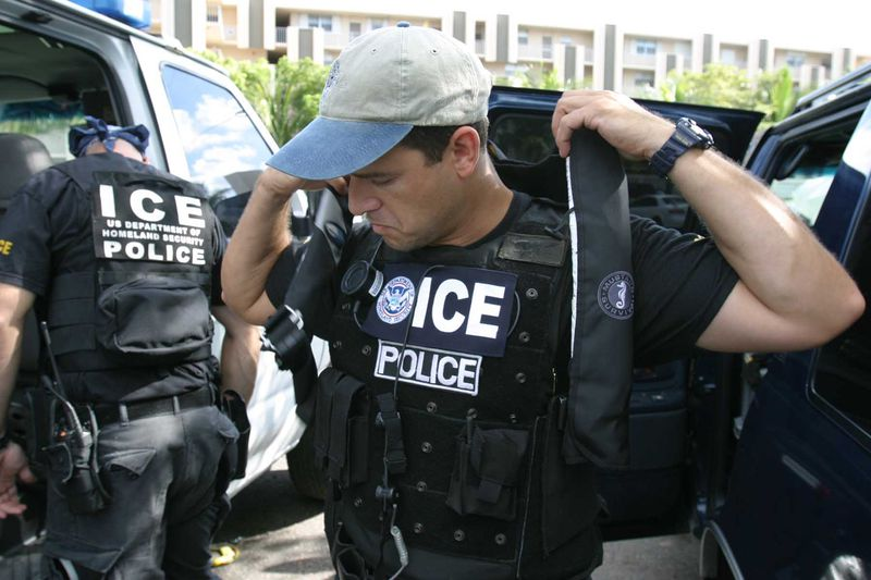 ICE officer putting on his SWAT gear