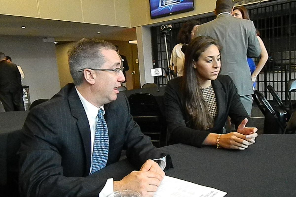 nec coaches discuss the qualities of a good official swish appeal farleigh dickinson coach peter cinella and redshirt junior erika livermore at nec media day photo by ray floriani