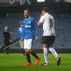 Ross Lyon berates the assistant referee on the Bill Struth Main Stand side at Ibrox<br>