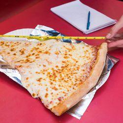 Measuring pizza at Pizza Boli's
