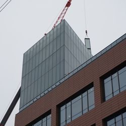 It does not appear that there will be a clock tower, on top of the plaza building