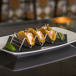 Lobster tacos with avocado, lime, and corn salsa are on the small plates menu