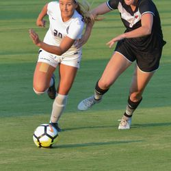 MANHATTAN, KANSAS - Kansas State forward Katie Cramer escapes a defender during K-State's 2-0 victory over Omaha on August 30, 2017.