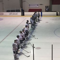 The Dallas Fire Department hockey team lines up for the national anthem at the inaugural Dallas Strong Hockey charity game.
