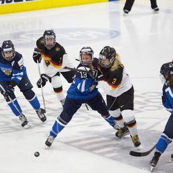 Team Germany foward Sophie Kratzer and Team Finland forward Riikka Valila battle on the opening faceoff.
