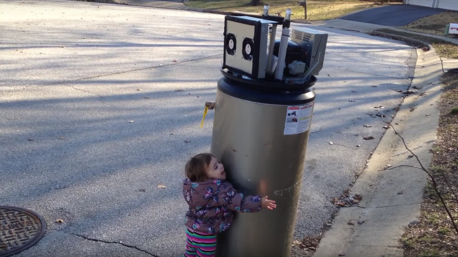 Tiny Child Mistakes Broken Water Heater for a Robot