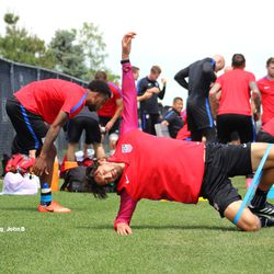 Stretching before an easy practice.