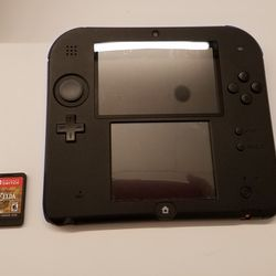 The 2DS is a bit longer than the 3DS XL, but it's not that different in size. Either way — it's bigger than the Switch cart.