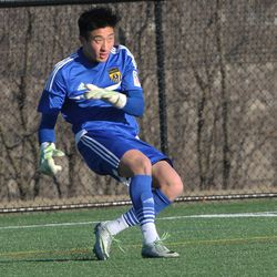 Continental FC goalkeeper Aaron Schwartz clears the ball