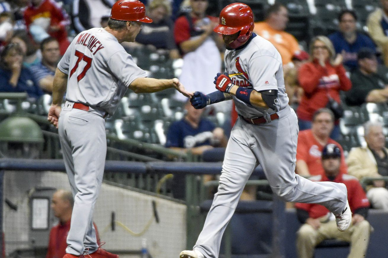 Late throwing error lifts Cardinals to 6-5 win over Brewers