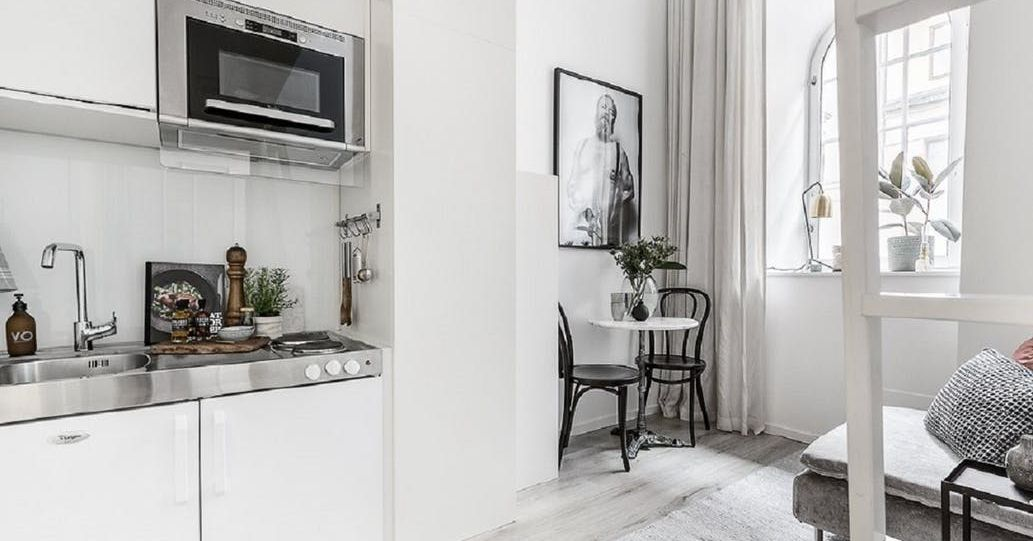Small living is taken to a stylish extreme in 100 square for 100 square foot room