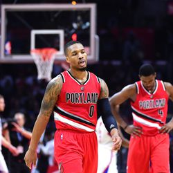 Damian Lillard and Maurice Harkless in the latest incarnation of the red alternates.