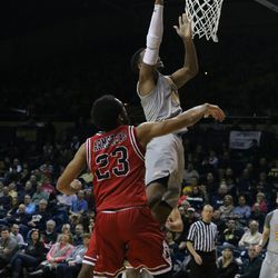 Johnathan Williams scooping it in for the basket.<br>