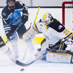 Boston Pride Goaltender Brittany Ott makes a saves while her defense desperately tries to clear the bouncing puck out of the slot.